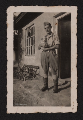 Man holding a young dog.