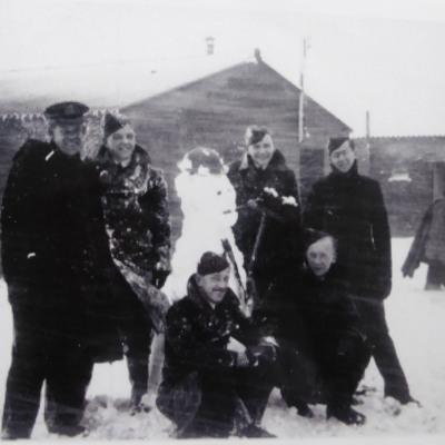 Snowman and six airmen