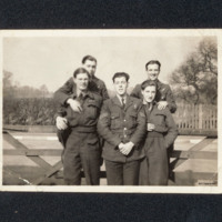 Group of airmen in front of a gate