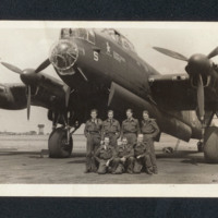 Seven airmen in front of a Lancaster