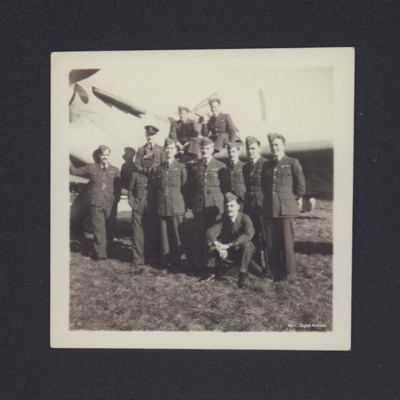 Group of pilots in front of Hawker Henley