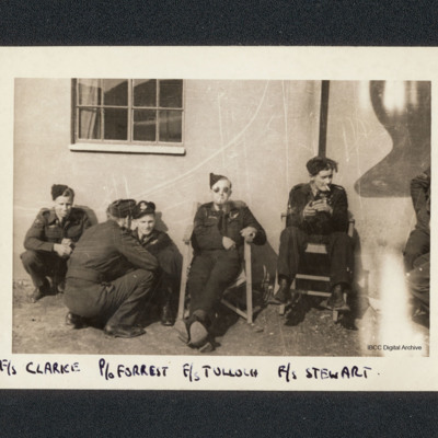 Five aircrew in front of hut