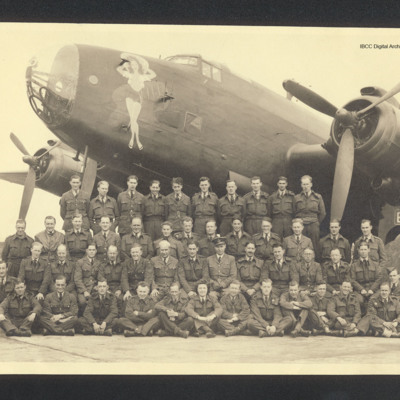 Group of Royal Air Force personnel in front of a Halifax