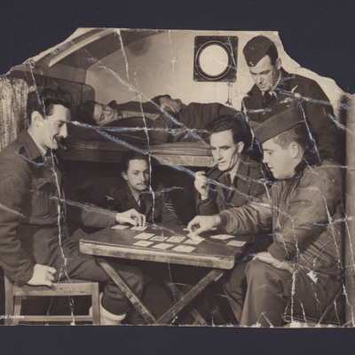 Five airmen playing cards