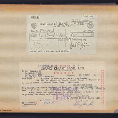 Two cheques on a scrapbook page made payable to Stan Attwood