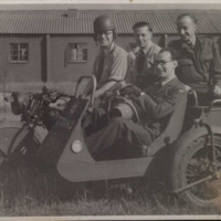 Ground personnel on a motorcycle and sidecar