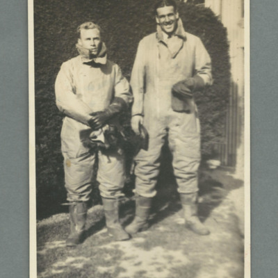 Two aircrew in Sidcot flying suits