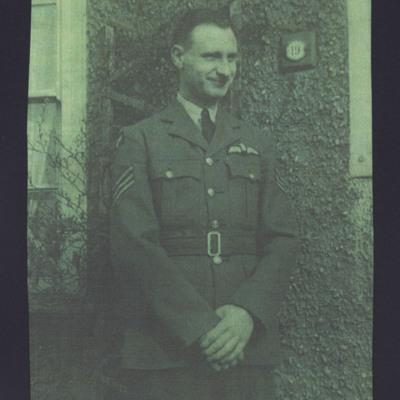 John Guyer Wilson in front of a house