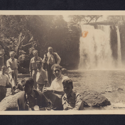 Group of men by waterfall