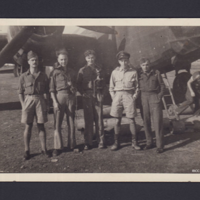 Five airmen in front of a Wellington