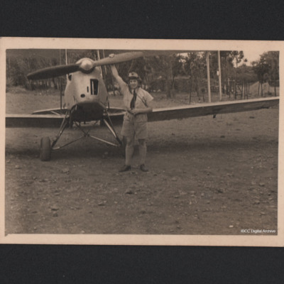 Clifford Watson in tropical dress wth a Tiger Moth
