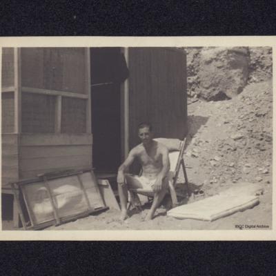 Rex Searle and a beach cabin