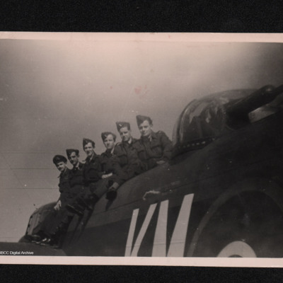 Six airmen sitting on a Lancaster