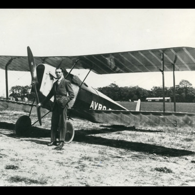 Roy Chadwick in front of an Avro Baby