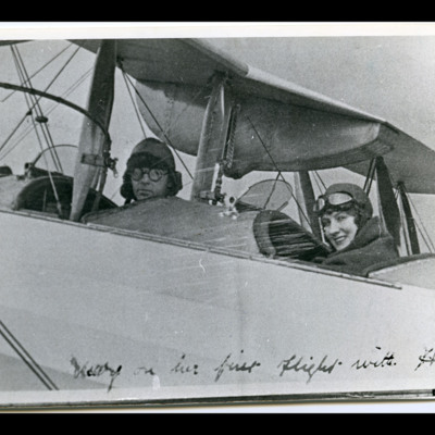 Mary Chadwick and Bert Hinkler in cockpits of a biplane