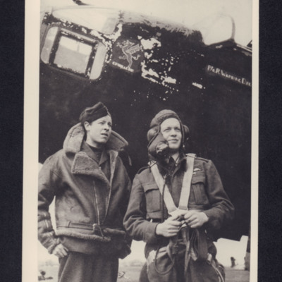 Two aircrew in front of a Hampden