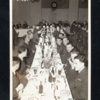 Airmen seated at formal dinner