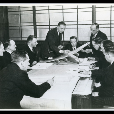Roy Chadwick and nine men around a table