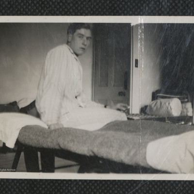 Man sitting on bed