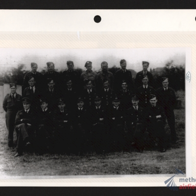 Group of RAF aircrew with two USAAF airmen