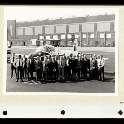 Group of veterans standing with a Jet Provost