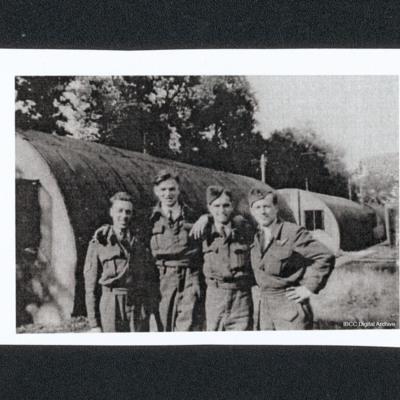 Four airmen by Nissen huts