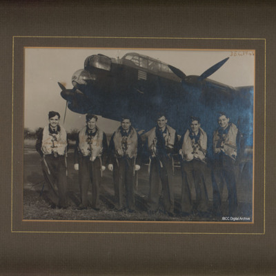 Six aircrew in front of Lancaster