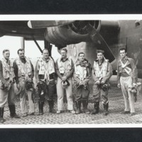 Seven aircrew in front of a B-24