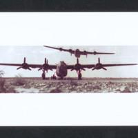 Two B-24s in a desert landscape