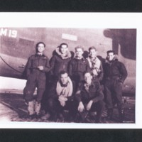 Aircrew in front of a B-24