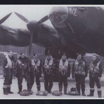 Seven aircrew in front of a Lancaster