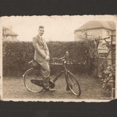 Reg Jaques on a bicycle