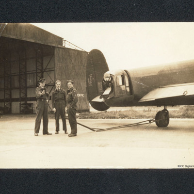 Three airmen and Lancaster