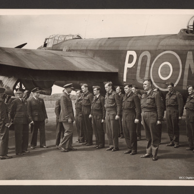 Aircrew and ground crew inspected in front of Lancaster PO-M
