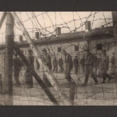 Prisoners of war behind wire