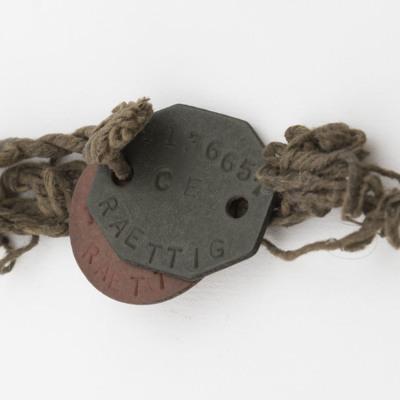 Dennis Raettig's dog tags