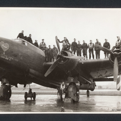 Group of air and ground crew standing on a Halifax
