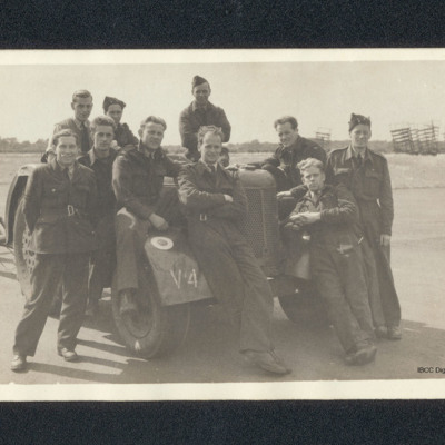Ten airmen with a tractor