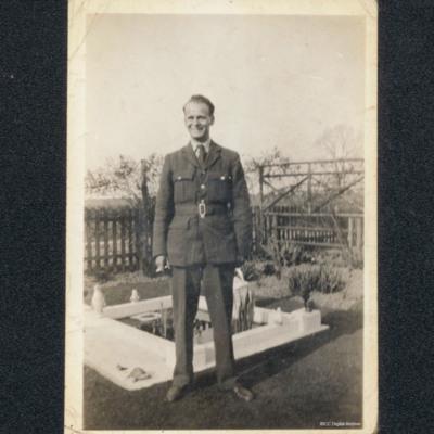 Dennis Raettig in uniform standing in a garden