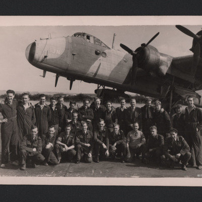 Group of airmen and civilians in front of a Stirling