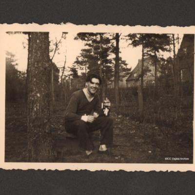 Man seated in garden