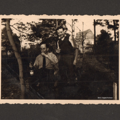 Two men drinking in a garden