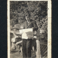 George Reid Williamson reading a newspaper in the Bois de Boulogne