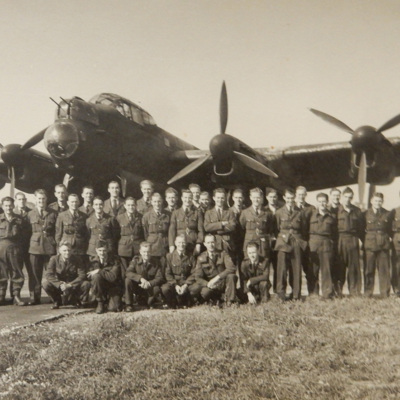 Large group of airmen in front of a Lancaster