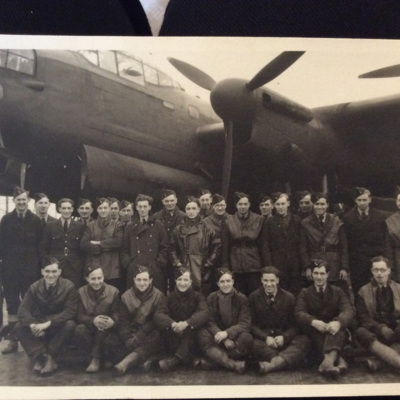 Group of airmen in front of a Lancaster