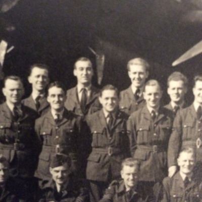 Twelve airmen in front of a Lancaster