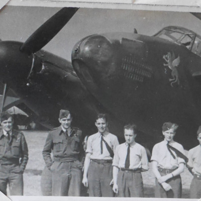 Six airmen in front of a Mosquito