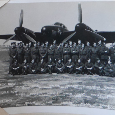 Thirty five airmen in front of a Mosquito
