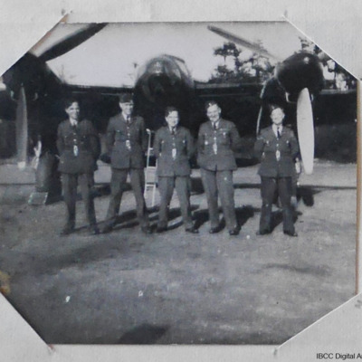 Five airmen in front of a Mosquito