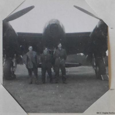 Three airmen in front of a Mosquito
